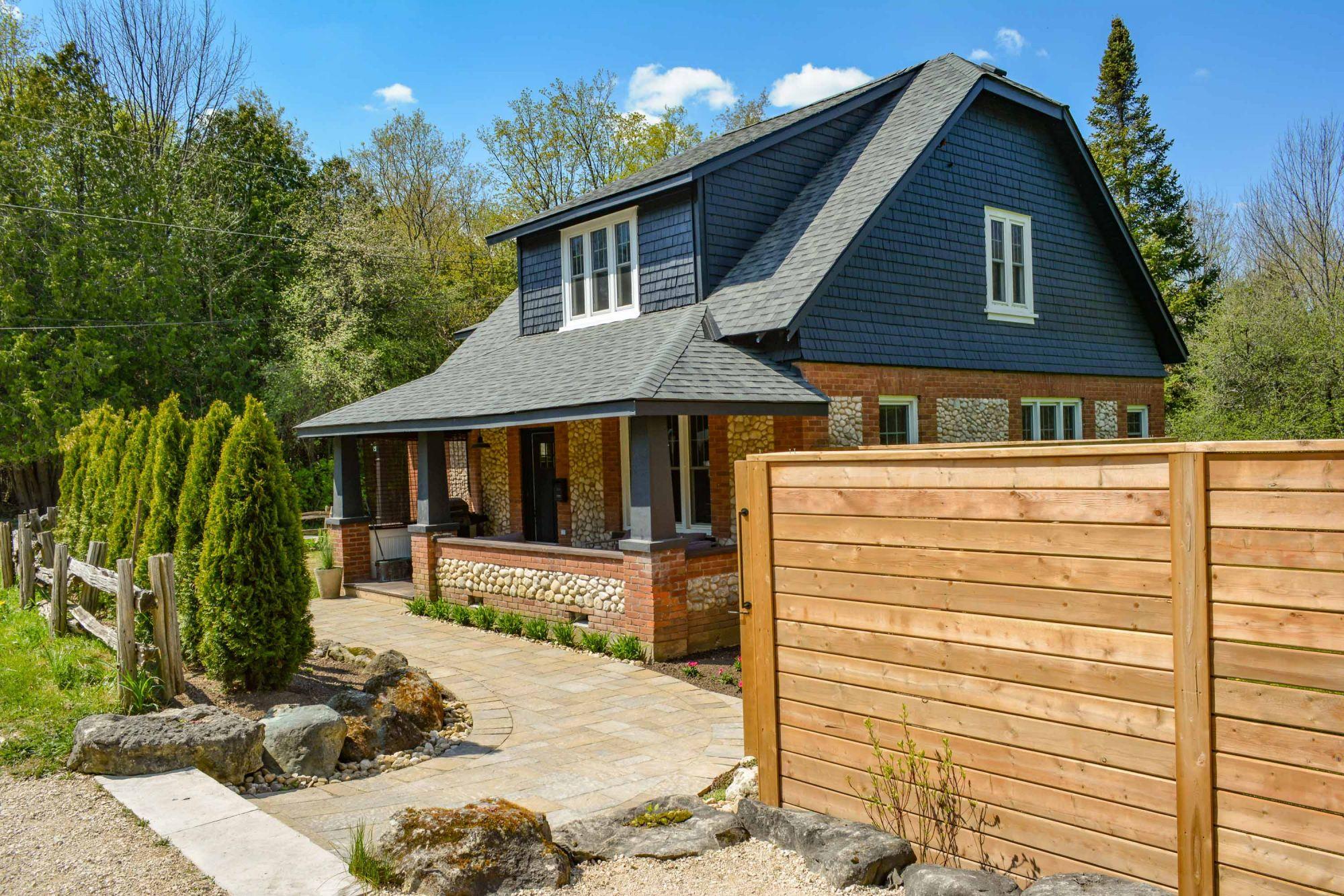 Charming Craftsman Brick & River Stone Cottage